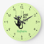 Naughty cat scratching the wall large clock