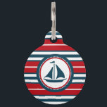 "Nautical design pet ID tag<br><div class=""desc"">Nautical design with sailing boat decoration in round shape on red,  blue and white striped background</div>"