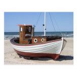 Nautical Fishing Boat sitting on Sandy Ocean Beach Post Cards