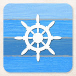 """Nautical themed design square paper coaster<br><div class=""""desc"""">Nautical themed design with sailing wheel decoration on striped blue and gray wooden background. Please note this is not made of wood,  it is a wood graphic print.</div>"""
