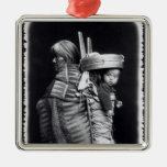 Navaho woman carrying a papoose on her back metal ornament