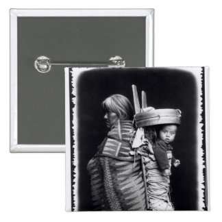 Navaho woman carrying a papoose on her back pinback button