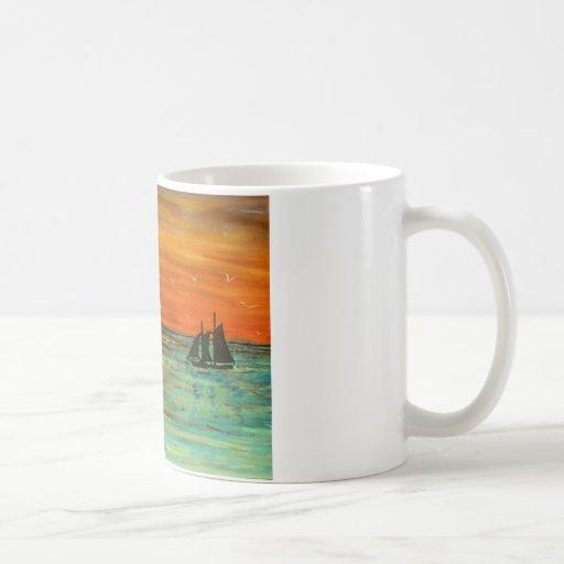 Navegación en la puesta del sol tazas de café
