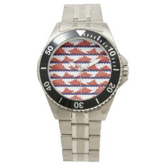 Naves del rojo en ondas azules náuticas relojes