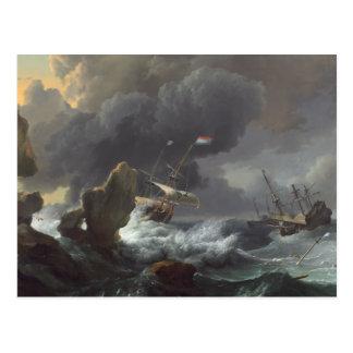 Naves en la desolación de una costa rocosa postal