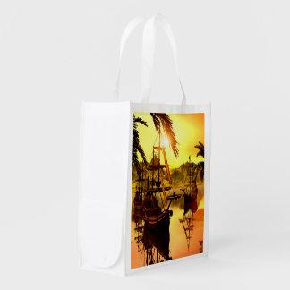 Naves en la puesta del sol bolsa para la compra
