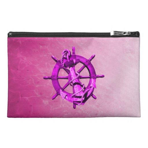 Naves náuticas rosadas rueda y ancla