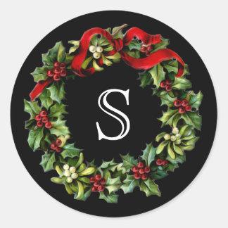 Navidad de la guirnalda del acebo de la letra del pegatina redonda
