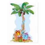 Navidad de la palmera con los regalos postal