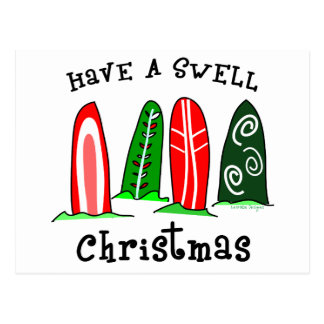 Navidad de la persona que practica surf tarjetas postales