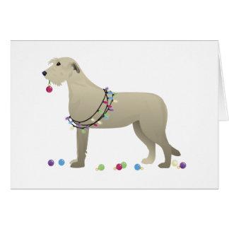 Navidad de la silueta de la raza del perro del tarjeta de felicitación