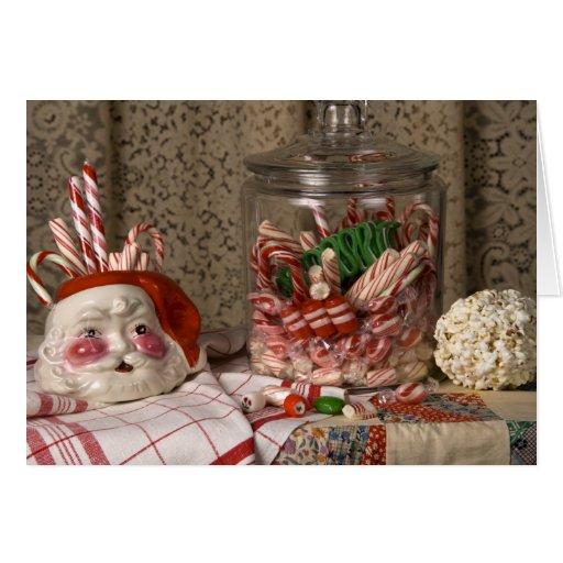 Navidad de los bastones del florero y de caramelo tarjeta de felicitación