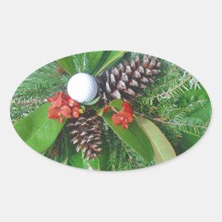 Navidad de los conos y de los árboles de hoja pegatina ovalada