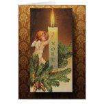 Navidad del ángel y de la luz de una vela del tarjeta de felicitación