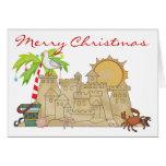Navidad del castillo de arena de la playa tarjeta