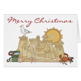 Navidad del castillo de arena de la playa tarjeta de felicitación