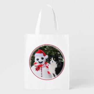 Navidad del gato y del muñeco de nieve de Santa Bolsa Para La Compra