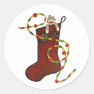 Navidad del mono del calcetín que almacena al pega etiquetas redondas