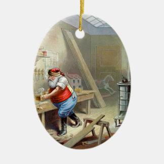 Navidad del padre en su taller adorno ovalado de cerámica