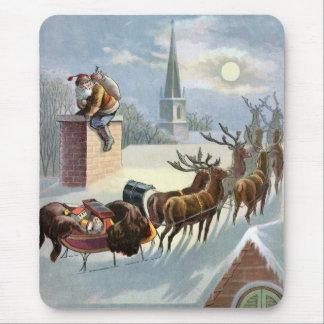 Navidad del padre que va abajo de la chimenea alfombrilla de raton