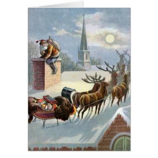 Navidad del padre que va abajo de la chimenea tarjeta de felicitación