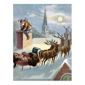 Navidad del padre que va abajo de la chimenea tarjeta postal