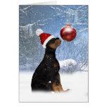 Navidad del perrito de Rottweiler - tarjeta del dí