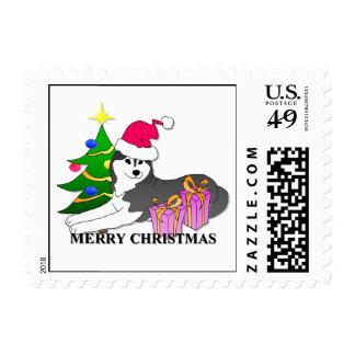 Navidad del perro del husky siberiano estampilla