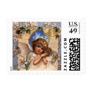 Navidad del vintage, ángel del Victorian con el Sellos Postales