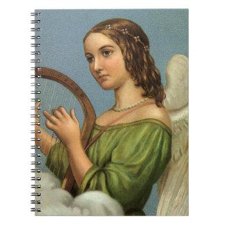 Navidad del vintage, ángel del Victorian con la Notebook