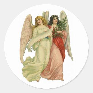 Navidad del vintage, ángeles angelicales del pegatina redonda
