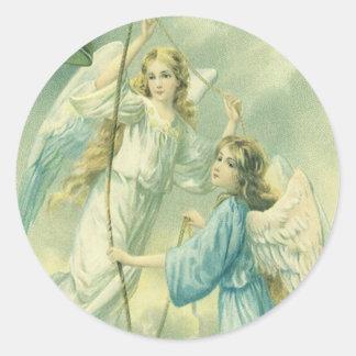 Navidad del vintage, ángeles del Victorian con una Pegatina Redonda