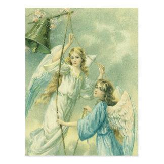 Navidad del vintage, ángeles del Victorian con una Postal