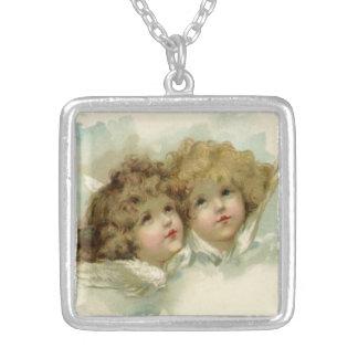 Navidad del vintage, ángeles del Victorian en las Collar Plateado