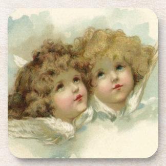 Navidad del vintage, ángeles del Victorian en las Posavasos De Bebida