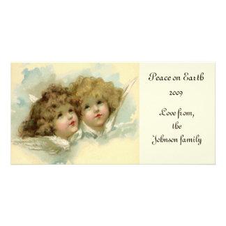 Navidad del vintage, ángeles del Victorian en las Tarjetas Fotograficas