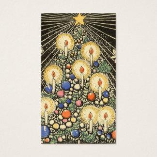 Navidad del vintage, árbol con las velas y una tarjeta de negocios