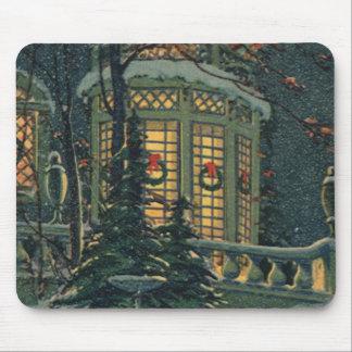 Navidad del vintage, casa con las guirnaldas en alfombrillas de raton