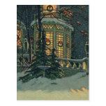 Navidad del vintage, casa con las guirnaldas en postal