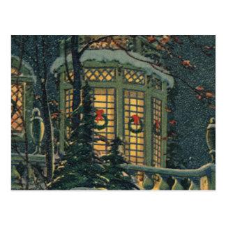Navidad del vintage, casa con las guirnaldas en tarjeta postal