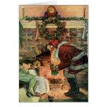 Navidad del vintage, chimenea de Papá Noel del Tarjeta De Felicitación