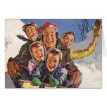Navidad del vintage, el Sledding feliz de la famil