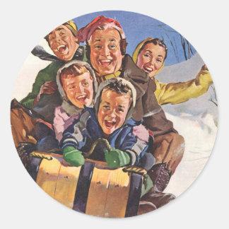 Navidad del vintage, el Sledding feliz de la Pegatina Redonda