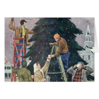Navidad del vintage, familia que ata luces en tarjeta de felicitación