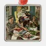 Navidad del vintage, familia que envuelve los rega