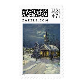 Navidad del vintage, iglesia del invierno en claro estampilla