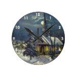 Navidad del vintage, iglesia del invierno en claro reloj redondo mediano