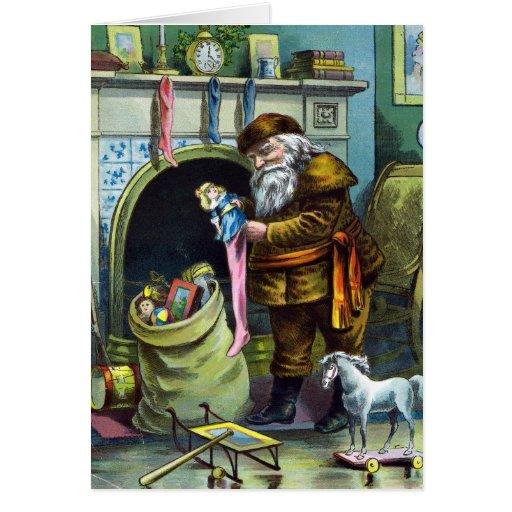 Navidad del vintage, juguetes de Papá Noel y Tarjeta Pequeña