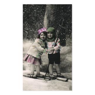 Navidad del vintage, mejores amigos en los esquís tarjetas de visita