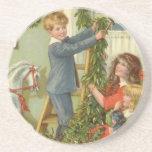 Navidad del vintage, niños del Victorian que Posavaso Para Bebida